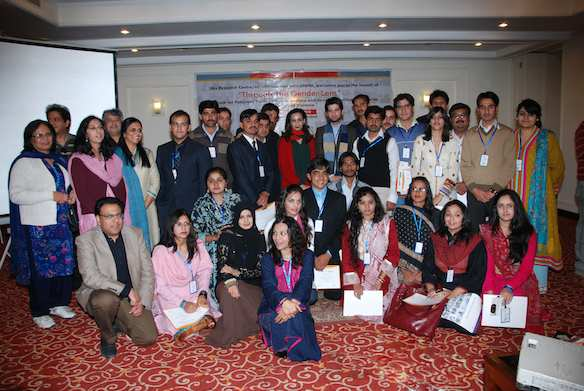 Youth participants pose with their mentors at the December 2010 launch of Through the Gender Lens, a handbook to help combat violence against women.