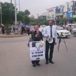 Human rights activist Tahira Abdullah addresses demonstrators. Wahaj us Siraj of ISPAK to her right.