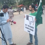 Usama Khilji of Bolo Bhi speaks to the media at the demonstration.